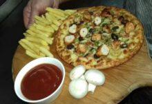 صورة بيتزا الدجاج بالمشروم وجبن الموتزاريلا